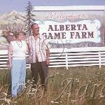 Couple posing in front of the game farm sign